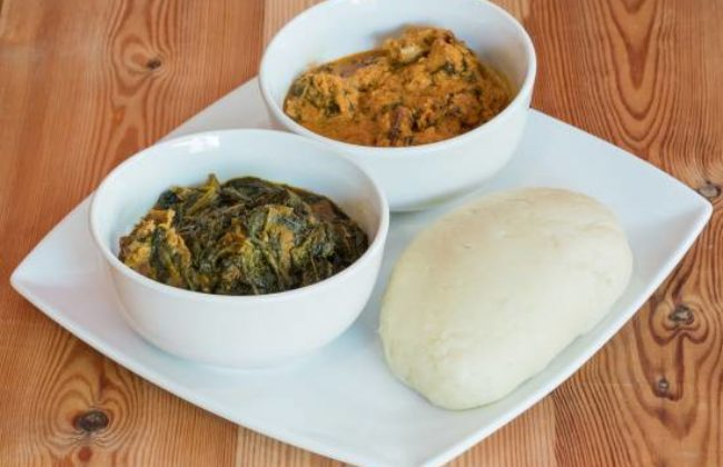 Pounded Yam with Vegetable and Egusi Soup.