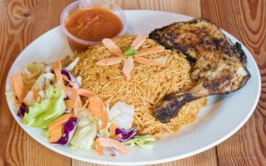 Jollof Rice and Grilled Chicken with Salad