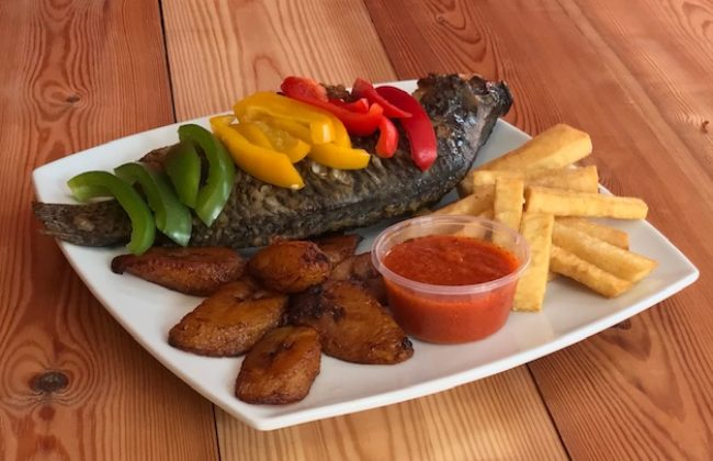 Grilled Tilapia with Fried Plantain and Chips.